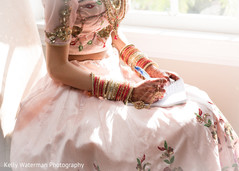 Indian bride writing her vows before wedding ceremony