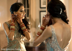 Indian bride getting ready for wedding reception
