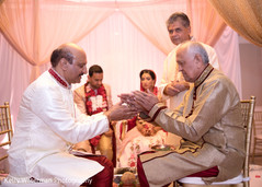 Indian couple fathers photography at wedding ceremony