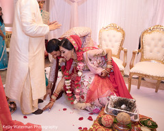 Indian couple touching priest feet at wedding ceremony