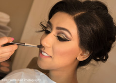Beautiful indian bride getting ready for wedding reception