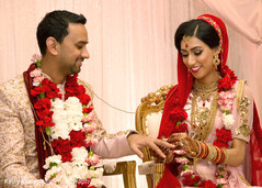 Indian couple exchanging rings at wedding ceremony