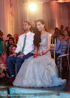 Indian couple having a great time at wedding reception