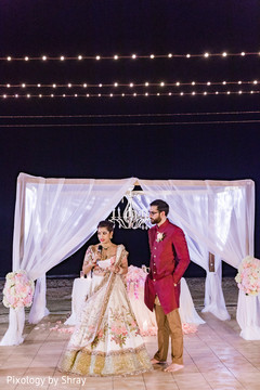 destination wedding reception,indian bride,indian groom,indian wedding floral and decor