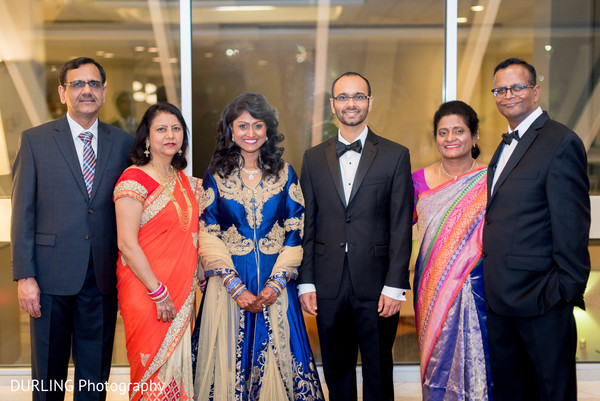 Indian couple and their parents photography before wedding reception