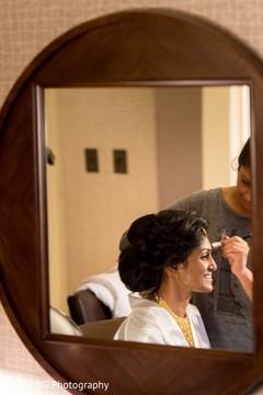 indian bride getting ready,indian bride makeup,indian bride