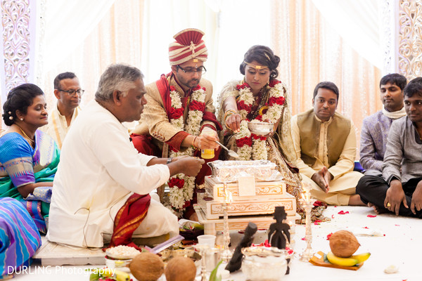 Indian couple and priest photography at wedding ceremony