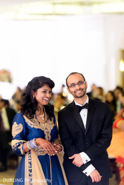 Indian couple smiling photography at wedding reception