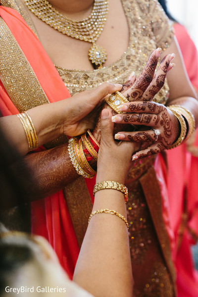 Indian bride trying her bangles before wedding ceremony