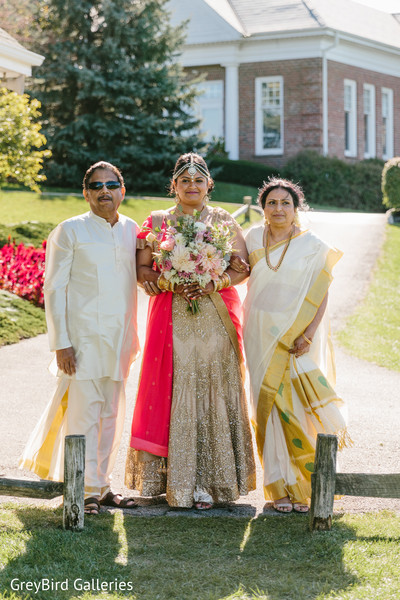 Indian bride and her parents photography before wedding ceremony