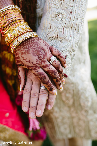 Indian couple showing their wedding rings photography
