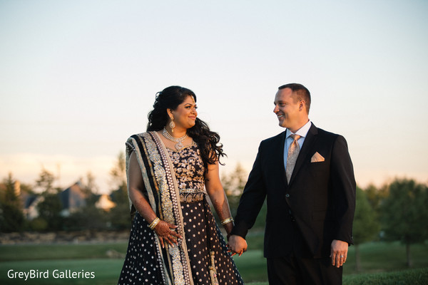 Indian couple holding hands photography before wedding reception