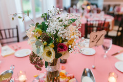 table centerpieces,indian wedding reception floral and decor,indian wedding photography