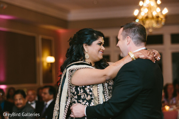 Indian couple dancing for the first time at wedding reception