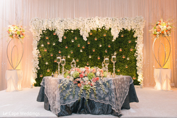 flower decor on table for indian couple at wedding reception in