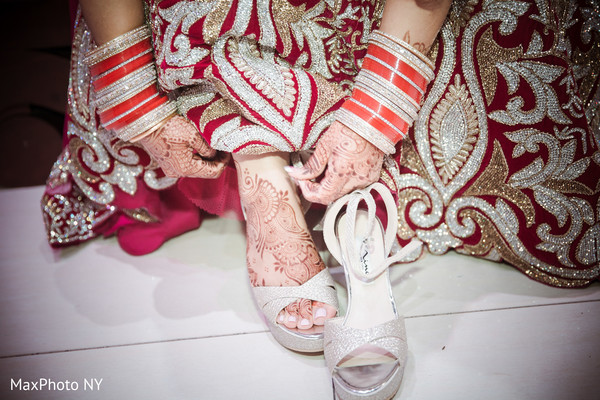 Indian bride trying her shoes before wedding reception in Queens, NY Wedding by MaxPhoto NY