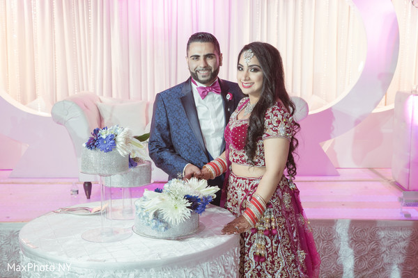Indian couple about to cut the cake at wedding reception in Queens, NY Wedding by MaxPhoto NY