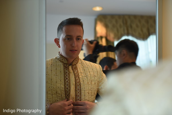 Indian groom getting ready.