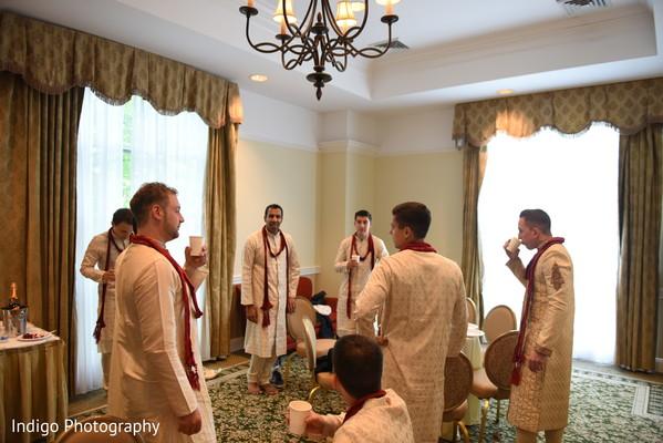 Indian groomsmen getting ready.
