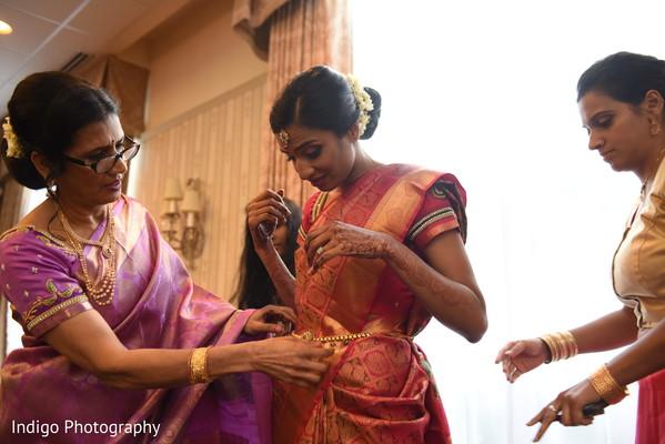 Indian bride's sari draping.