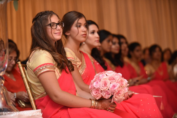 Lovely bridesmaids in coral saris.