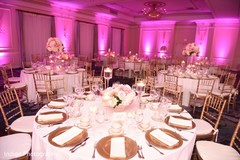 reception,hot pink lighting,centerpiece,table decoration
