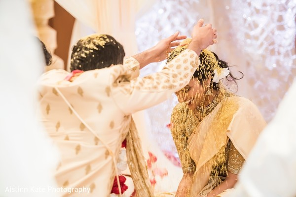 Bride being showered in rice.