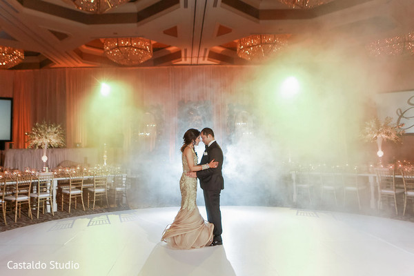 Lovely indian couple first dance at wedding reception
