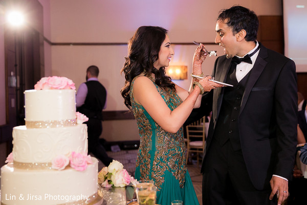 indian bride and groom,indian wedding reception,wedding cake