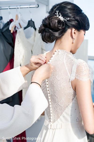 Beautiful bride getting ready.