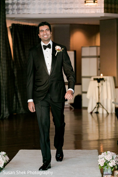 Elegant groom entering the ceremony venue.