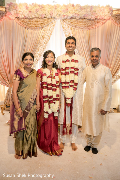 Indian  couple's with groom's parents.