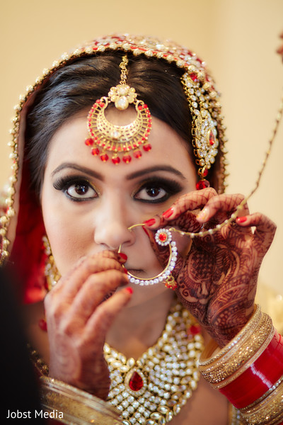 indian bridal makeup,indian bride getting ready,henna