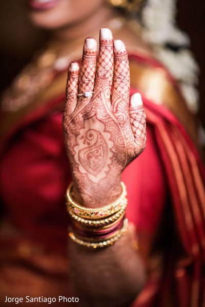 Indian bride showing her mehndi art before wedding ceremony in Pittsburgh, PA Indian Wedding by Jorge Santiago Photography
