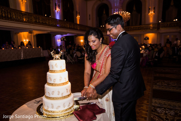 Indian couple cutting the wedding cake in Pittsburgh, PA Indian Wedding by Jorge Santiago Photography