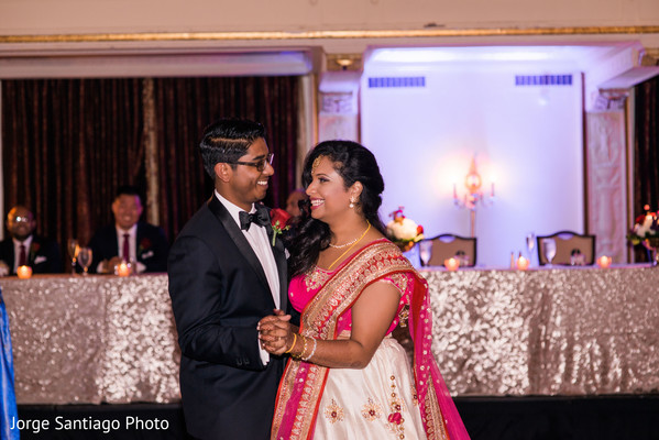 Happy couple during their first dance in Pittsburgh, PA Indian Wedding by Jorge Santiago Photography
