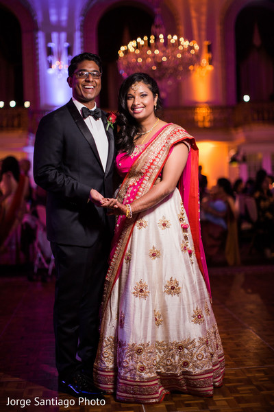 Lovely white and pink bridal lengha in Pittsburgh, PA Indian Wedding by Jorge Santiago Photography