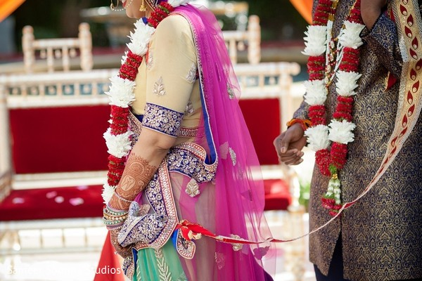Bride and groom tying the knot. in Redwood City Indian Wedding by Sameer Soorma Studios