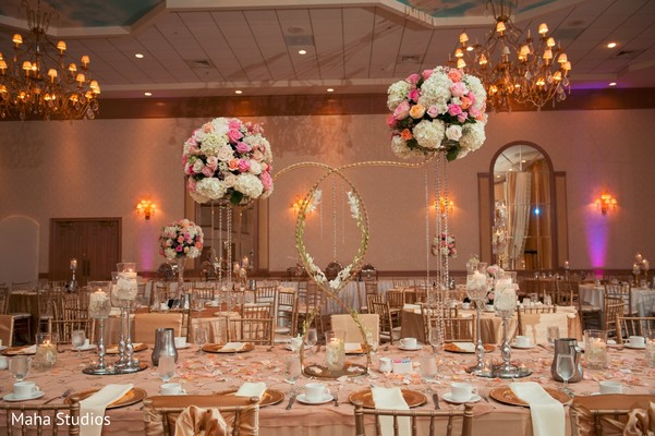 Table centerpieces at indian wedding reception