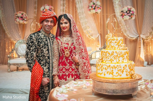 Indian couple and wedding cake photography
