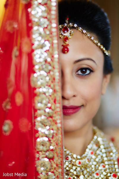 indian bride hair and makeup,indian bridal makeup,tikka