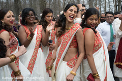 Indian bridesmaids having fun before wedding ceremony