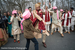 Indian groom dancing at baraat procession