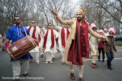 Indian groom and groomsmen dancing at baraat procession