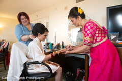 indian bride getting ready,bride bangles,indian bride hair and makeup