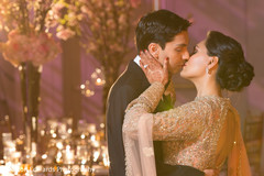 Indian couple kissing photography at wedding reception