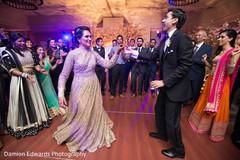 lightning,floral centerpieces,indian wedding reception decor