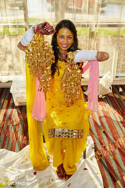 Indian bride showing her jewelry at haldi ceremony