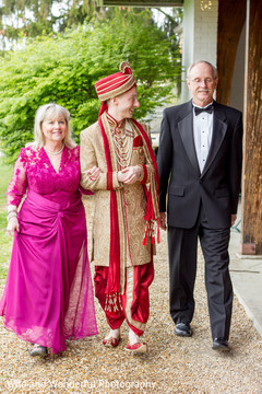 Indian groom escorted to the ceremony by his parents.