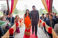 Astounding Indian bridal party walking down the aisle.